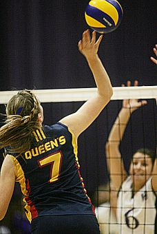 Queen's middle hitter Colleen Ogilvie goes up for a hit against Western middle hitter Sara Farrell Saturday night. The Gaels lost 3-1 to the Mustangs, but beat the Windsor Lancers Friday.