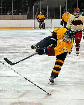 Queen's interim captain Billy Burke takes a shot against RMC Saturday.