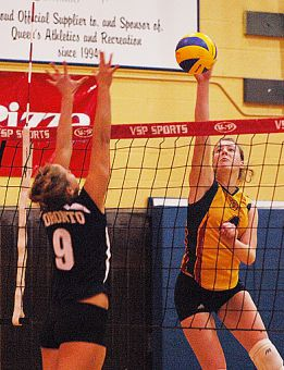 Queen's outside hitter Lorna Button tips the ball Friday night at Bartlett Gym against U of T's Heather Bansley. The Gaels lost in five sets.