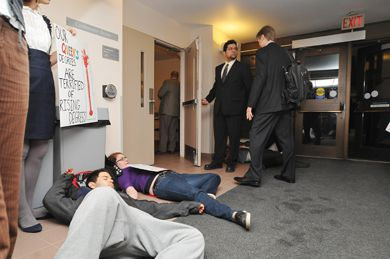 """On Mar. 6, members of Queen's Action Backing Climate Change staged a """"die-in"""" in front of the Board of Trustees meeting to bring attention to Queen's carbon footprint."""