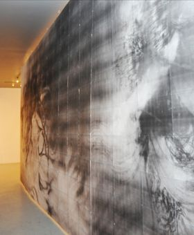 Artist Huang's created a paper hallway dividing the space in the Modern Fuel Artist-Run Centre.