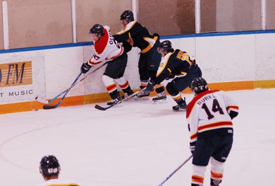 Former Queen's forward Brady Olsen battles a Ryerson Rams' defender for the puck in a Feb. 9, 2007 game. He now plays in the Central Hockey League for the Rapid City Rush of South Dakota.