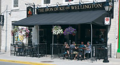 Outdoor patios like the Duke of Wellington's are a popular destination for Kingston's summer residents.