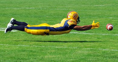 Wide receiver Mark Surya sprawls to make a catch that would have added to Danny Brannagan's 495 pass yards on Monday's 52-49 win over Guelph.