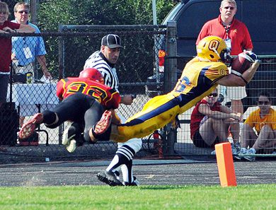 Allin dives into the end zone for one of his three touchdowns on the day.