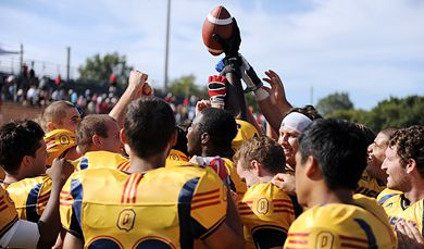 The Gaels' defensive unit celebrates being awarded the game ball.