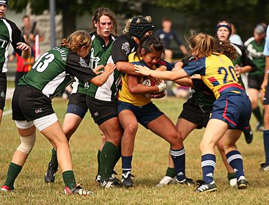 Gaels' fullback Karlye Wong fights for inches against a Trent pack during Saturday's 36-30 Queen's win over the Trent Excalibur.