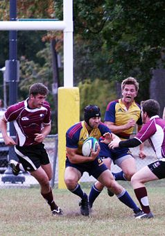 Queen's eight-man Tim Richardson evades two tackles to bring the ball out of the Tricolour end durinng the Gaels' 59-5 win over McMaster.