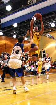 Queen's forward Mitch Leger goes for the bucket during the Gaels 90-33 win over the Eagles.