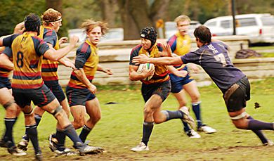 Eight-man Tim Richardson sets up for a stiff-arm against a Western tackle on Saturday in London. The Gaels won 13-12.