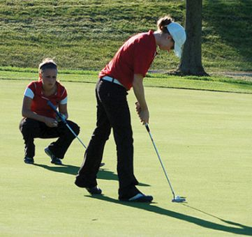 Women's captain Kate Burnett taps in a putt during the Queen's Invitational on Sept. 20 at the Amherstview Golf Club.