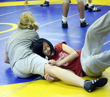 Journal news editor Gloria Er-Chua gets dropped by wrester Emily Peat.