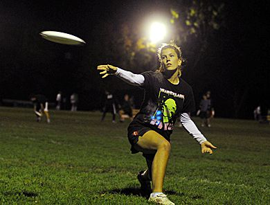 An ultimate frisbee player lets the disc fly during a practice at West Campus.