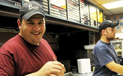 Long-time Bubba's employee George Doulas takes a break from serving poutine and prepares a sub last Thursday night.