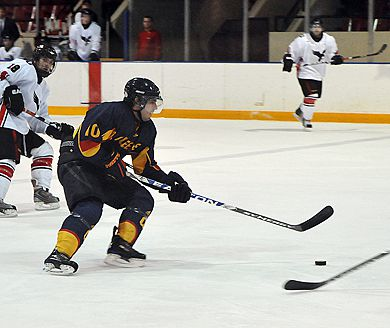 Joey Derochie drives the puck into the Carleton offensive zone during Saturday's 5-3 win over the Ravens.