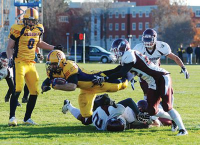 Gaels' running back Jimmy Therrien gets pulled down during Queen's 36-6 OUA semifinal win over the McMaster Marauders on Saturday at Richardson Stadium. Therrien picked up 89 total rushing yards and a touchdown in the game.