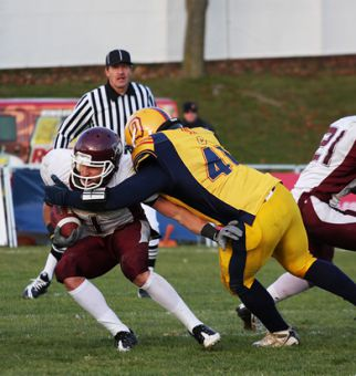 Gaels' linebacker T.J. Leeper drops Marauder wide reciever Michael DiCroce to the ground.