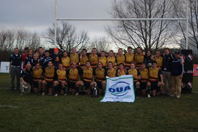 The OUA champion Queen's Gaels show off their hard-earned trophy and banner.