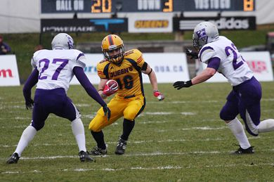 Kick returner Jimmy Allin returns a punt during Saturday's 43-39 win over Western at Richardson Stadium.