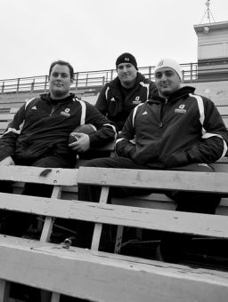 Offensive linemen Jonathan Koidis, Dan Bederman and Vince De Civita sit in the stands of Richardson Stadium before leaving for Quebec City on Tuesday.