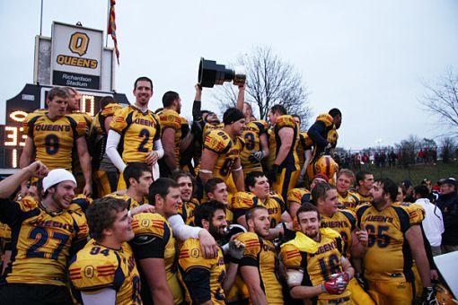 The football team celebrates winning the Mitchell Bowl after a shock 33-30 win over the first-ranked Laval Rouge-et-Or last Saturday at Richardson Stadium.