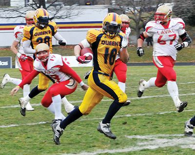 Returner Jimmy Allin scores a 120-yard kick-return against the Laval Rouge-et-Or last Saturday in the Mitchell Bowl. The touchdown gave Queen's the 33-30 victory, propelling the Gaels into tomorrow's Vanier Cup.