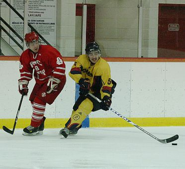 Defenceman Stephan Chabot eludes an RMC player during the Gaels' 4-3 shootout loss at the Constantine Arena on Nov. 11.