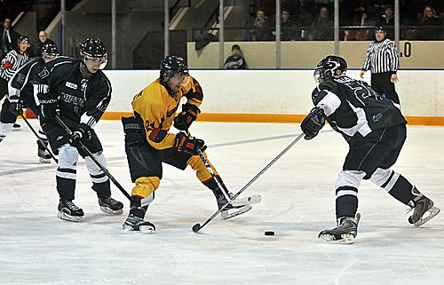 Forward Jeffery Johnstone attempts to manuever past a Nippissing defenceman at the Memorial Centre on Friday night.