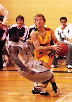 Guard Dan Bannister tries to drive past a McMaster defender during the Gaels' 56-50 loss to the Marauders on Nov. 7.