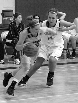 Guard Brittany Moore, pictured during the Gaels' Nov. 7 loss to the McMaster Marauders, is fifth in CIS scoring.