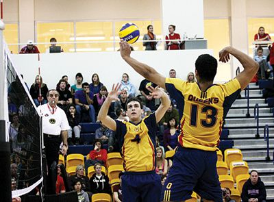 Setter Dan Rosenbaum puts the ball up for outside hitter Michael Amoroso during the Gaels' 3-1 loss to Waterloo.