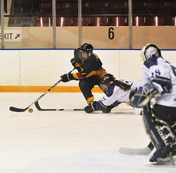 Forward Jess Cone moves around a sprawled Ridgeback defender during the Gaels' 4-3 overtime win on Saturday at the Memorial Centre. The Gaels also beat UOIT on Sunday.