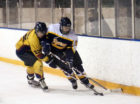 Gaels forward Jon Lawrance holds up a Ryerson defenseman during Saturday's 9-5 shellacking at the hands of the Rams.