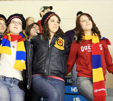 Queen's fans celebrate a Gaels goal with a rousing Oil Thigh.