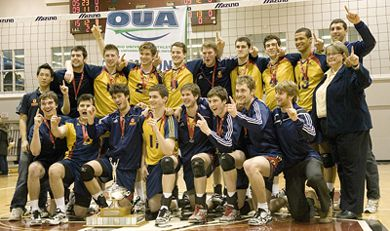 The men's volleyball team celebrate winning their first OUA title since 2007. The win booked the Gaels' tickets to the CIS Championships in Kamloops.