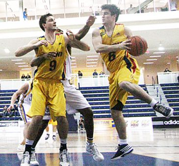Barrett (right) played as a guard for the basketball team after missing the first four games of the season due to rugby's extended playoff run.