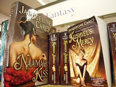 Fantasy novels in North America often feature detailed paintings on their covers, while the British versions are much plainer-looking because there's less emphasis on advertising the book. Fantasy writer Jacqueline Carey's Naamah's Kiss also promotes itself as a New York Times bestseller.