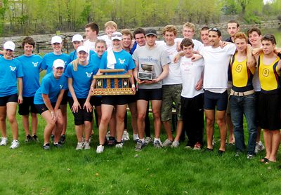 Rowing team poses with the D. Lornes trophy after win over the McGill Redmen on May 2.