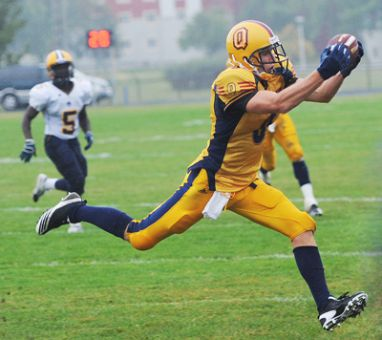 Receiver Devan Sheahan catches a pass at Richardson Stadium on Sunday. The Gael's home opener began with the raising of the 2009 Vanier Cup championship banner and appearences by former Gaels Danny Brannagan and Osie Ukwuoma.