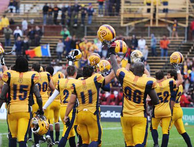 The football team salutes Gaels fans who stuck it out to watch the team win in a rain-filled affair. Over 4,000 students packed Richardson Stadium to watch quarterback Justin Chapdelaine dominate the Windsor Lancers in a 40-7 win.
