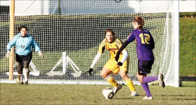 Goalkeeper Chantel Marson watches on as defender Summer Rybicki challenges a Laurier forward for the ball.
