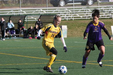 Gaels striker Jacqueline Tessier navigates around a Laurier defender at the CIS Championship in Charlottetown last Sunday.