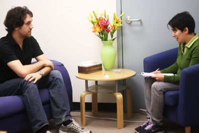 Facilitators of the Blue Sky Project conduct interviews with Queen's students at the mood lab in the Craine Building.