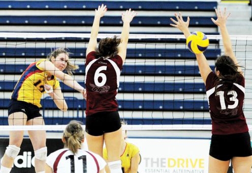 Middle Katie Matthews spikes the ball during the Gaels' straight-set win over the Ottawa Gee-Gees last Saturday at the ARC.