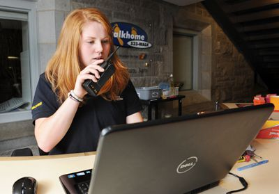 Robin Johannsen, Sci '12 and night co-ordinator for Walkhome dispatches teams via the radio.