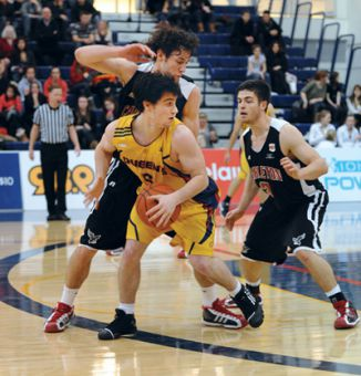 Guard Christ Barrett is blocked by the Ravens defence in their 86-73 loss.