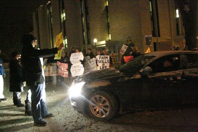 Over 100 protesters block cars outside the University Club where Minister of the Environment John Baird attends a fundraising dinner.