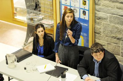 Presidential candidate Morgan Campbell (centre) , vice-presidential (Operations) candidate Ashley Eagan (left) and vice-presidential (University Affairs) candidate Kieran Slobodin (right) of Team CES say they want to encourage students to support Queen's athletic teams.
