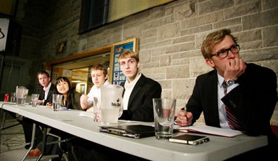 The student trustee candidates discuss their platforms at the debate last Thursday night in the JDUC.