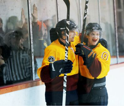 Forwards Jonathon Lawrance and Scott Kenway celebrate a goal in the Gaels' 5-2 win over the Paladins.